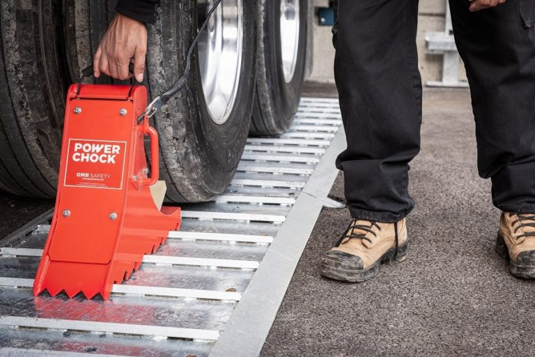 Portable-vehicle-restraint-POWERCHOCK-3-on-plate-in-front-of-truck-wheel