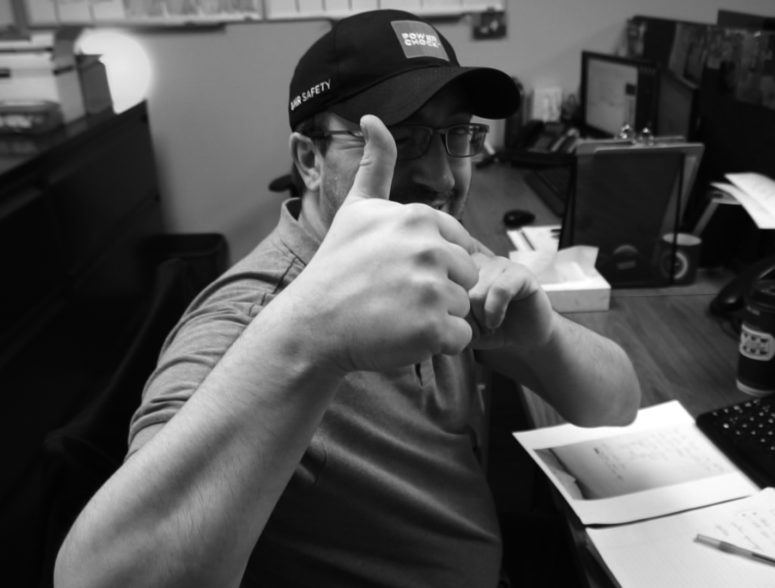 GMR Safety employee shows thumbs up