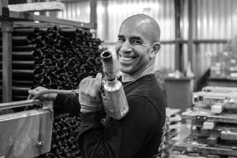 Wheel chock assembler GMR Safety employee